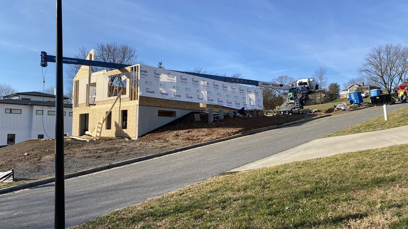 A crane collapsed on a Harrisonburg home that is currently under construction on Tuesday...