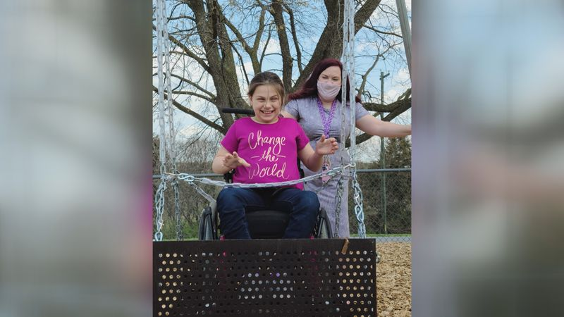 Students enjoy new wheelchair accessible swing at Sandy Hook Elementary School