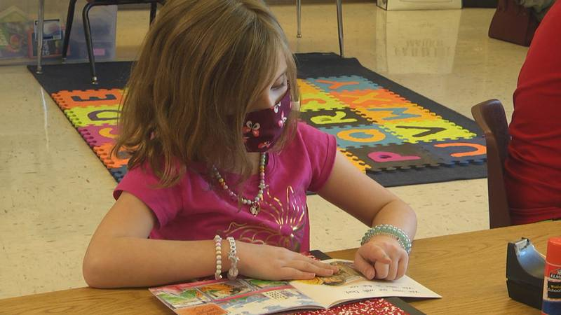 Westwood Hills Elementary School 2nd grader Katelyn Garber is practicing reading in a small...