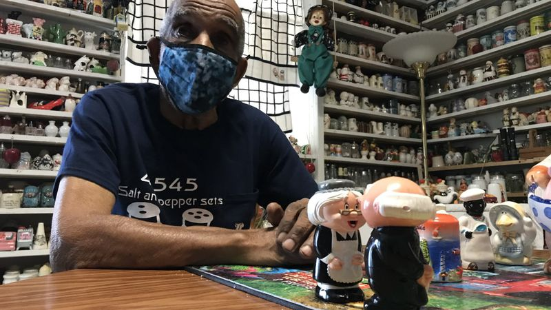 Leroy Watts sits amid some of his salt and pepper shaker collectionin Lexington, Va.