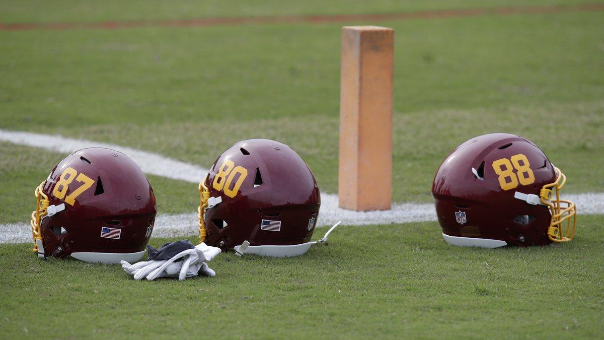 Washington Football Team helmets are seen on the field during an NFL football OTA at Inova...