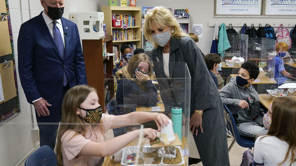 President Joe Biden and first lady Jill Biden, watch a student demonstrate her project, during...
