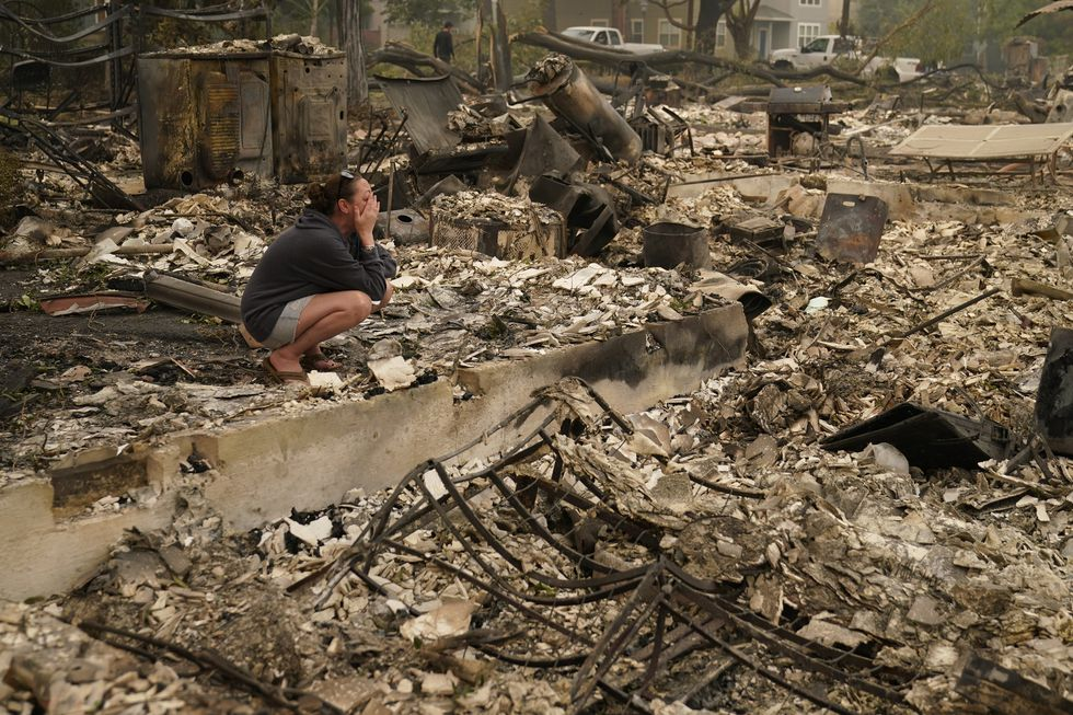 Desiree Pierce cries as she visits her home destroyed by the Almeda Fire, Friday, Sept. 11,...