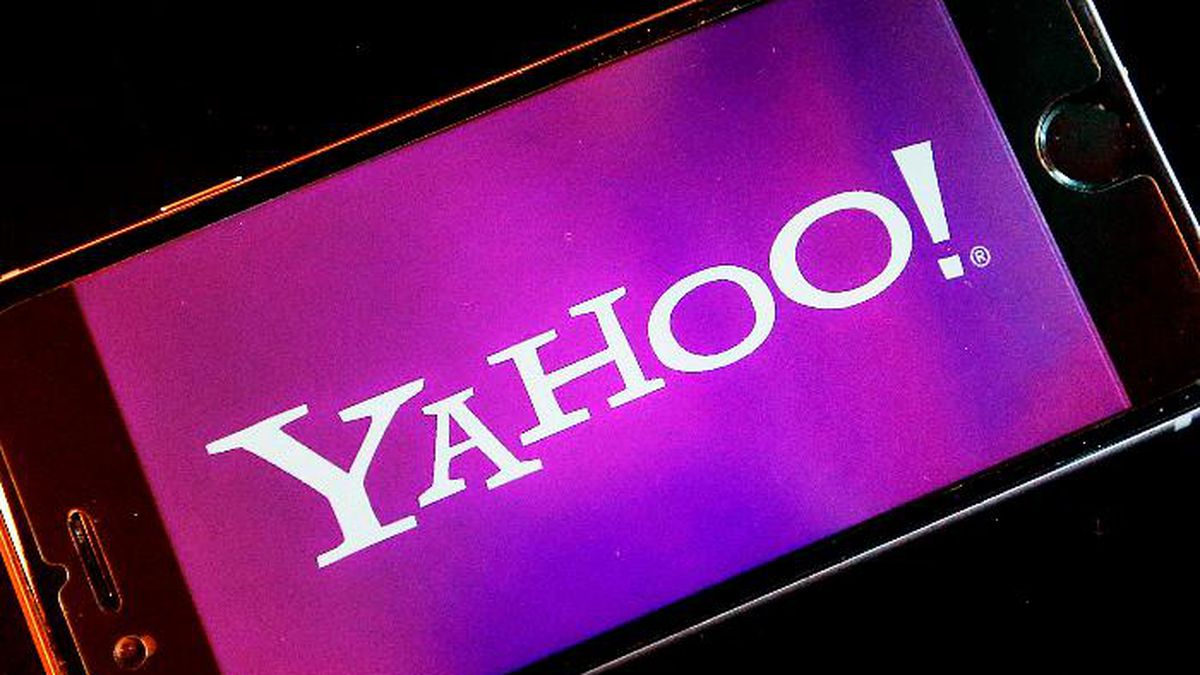 FILE - In this Dec. 15, 2016, file photo, the Yahoo logo appears on a smartphone in Frankfurt. A former Yahoo software engineer has pleaded guilty to hacking into the accounts of some 6,000 Yahoo users in search of sexual photos and videos. (AP Photo/Michael Probst, File)