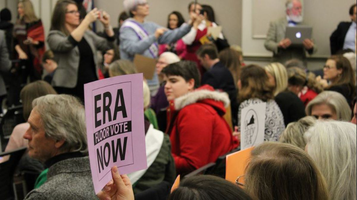 Advocates for the ERA, who made up a majority of the audience, enter a Virginia House of...