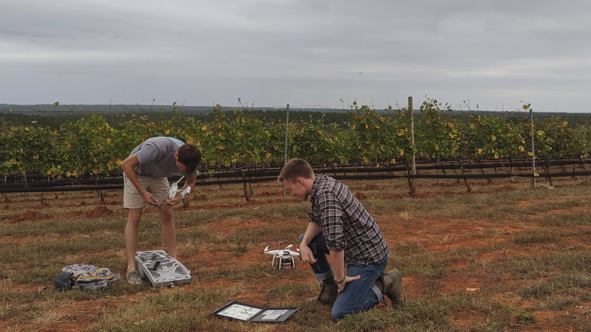 Students work on the drone before a flight around the vineyard | Photo: Brian Schieber