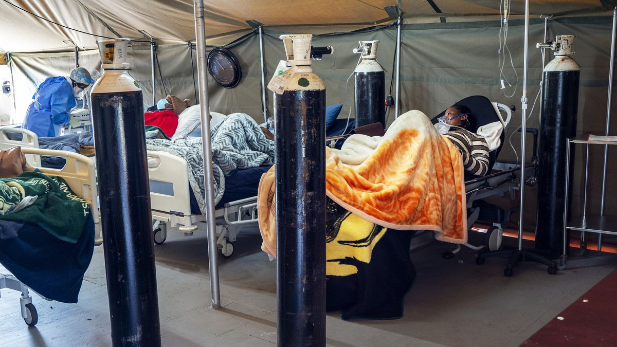 FILE - This July 10, 2020 file photo shows Covid-19 patients being treated with oxygen at the Tshwane District Hospital in Pretoria, South Africa. South Africa has exceeded 500.000 confirmed COVID-19 cases, representing more than 50% of all reported cases in Africa's 54 countries. Health Minister Zwelini Mkhize announced the new total on Saturday, Aug. 1, 2020.