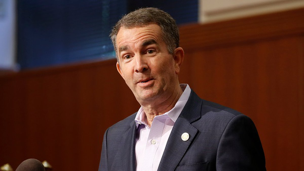 In this April 8, 2020 file photo, Virginia Gov. Ralph Northam gestures during a news...