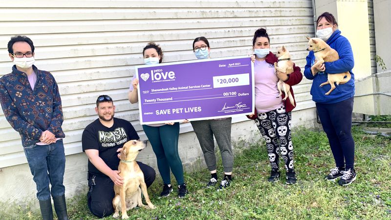 Team members with the Shenandoah Valley Animal Services Center hold a check invested by Petco...