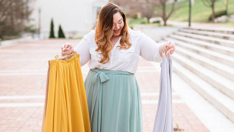 """Amanda Shrader poses with skirts, all part of her """"Skirt Project."""" (WHSV)"""
