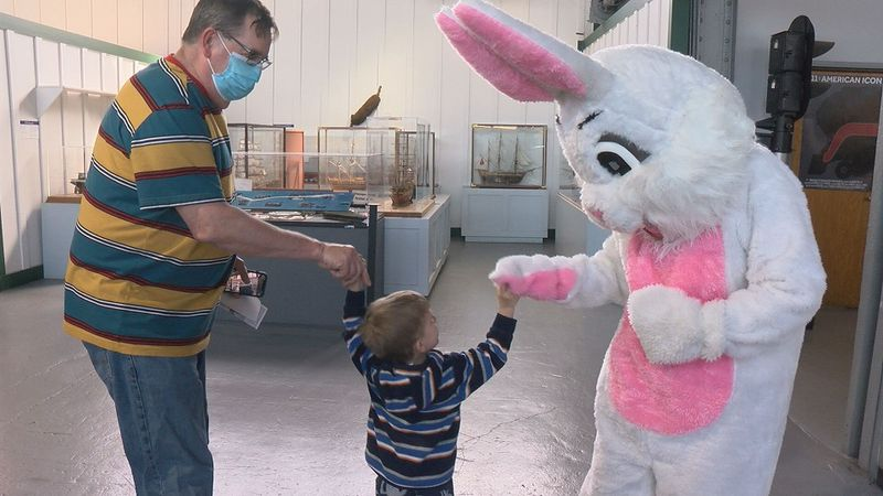 The Easter Bunny high fives a child at the Virginia Museum of Transportation on Friday.