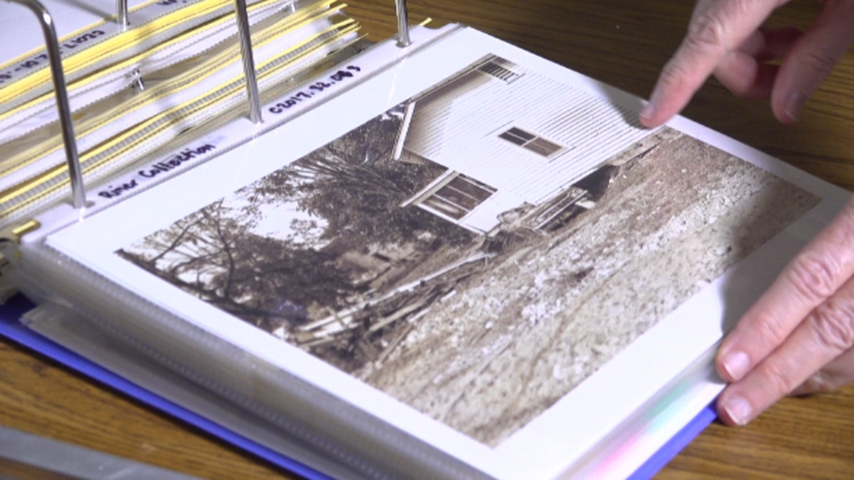 Jane Raup, archivist with the Nelson County Historical Society, flips through photos of the flood of 1969.