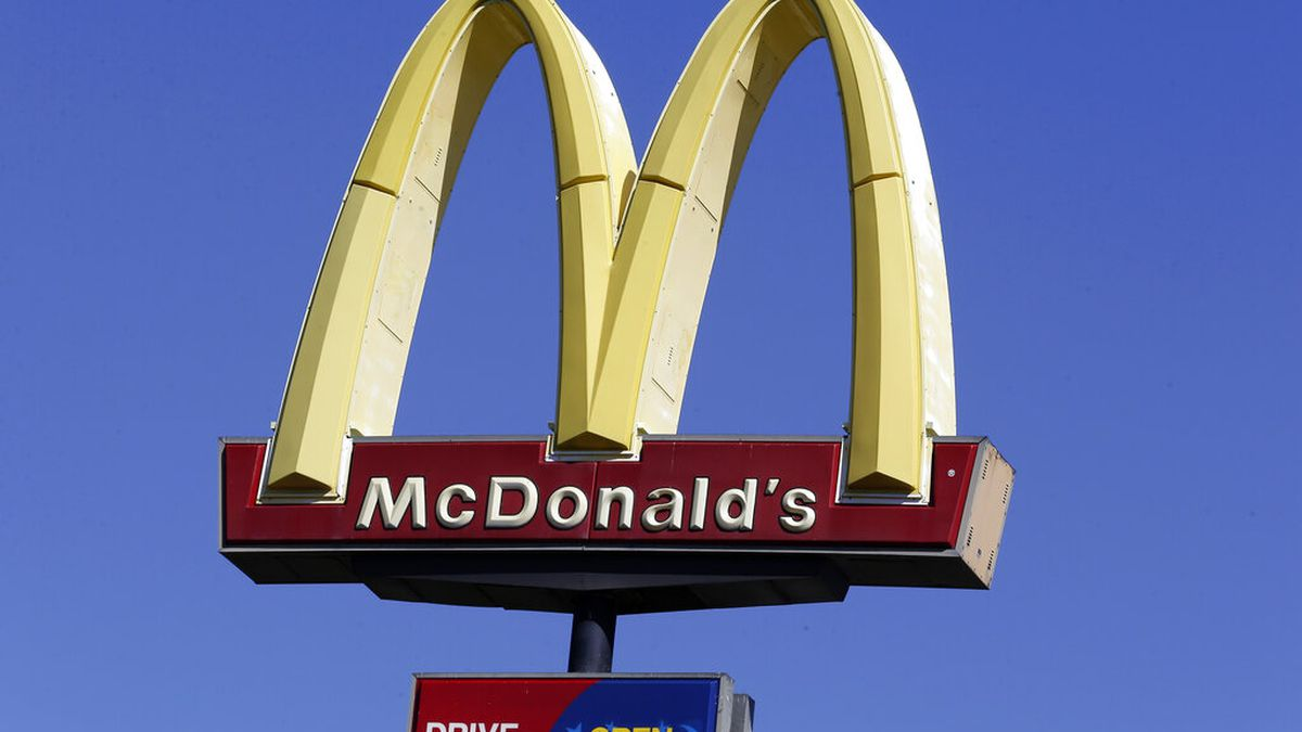 This Oct. 17, 2019 file photo shows a McDonald's sign along Interstate 40/85 in Burlington, N.C. McDonald's is suing a former CEO, alleging inappropriate relationships. (AP Photo/Gerry Broome, File)