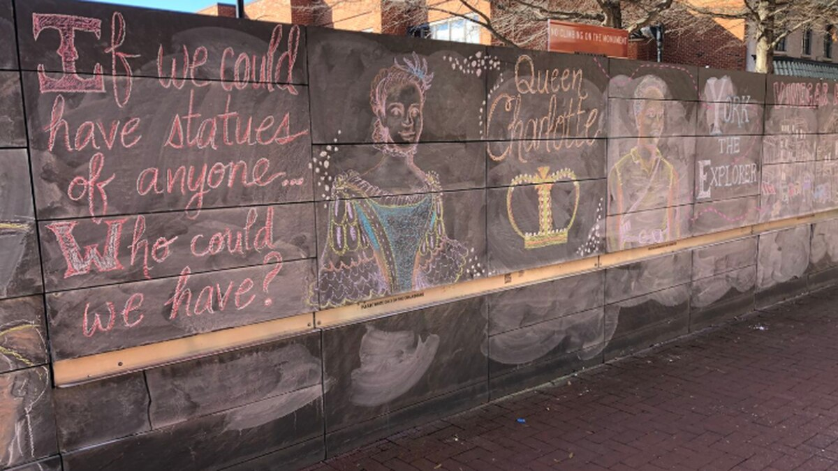 A panel of the Monumental Justice mural on Charlottesville's Downtown Mall, depicting possible...