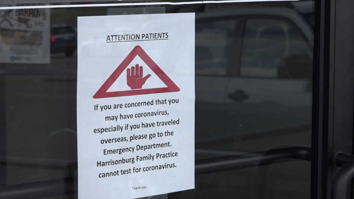 A sign hangs on the door of Harrisonburg Family Practice warning patients that if they believe...