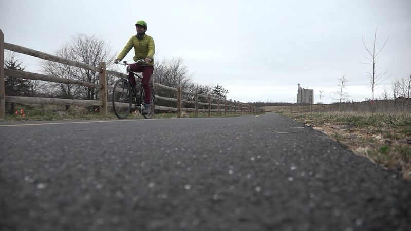 Kyle Lawrence of the Shenandoah Valley Bicycle Coalition rides along the Northend Greenway in...