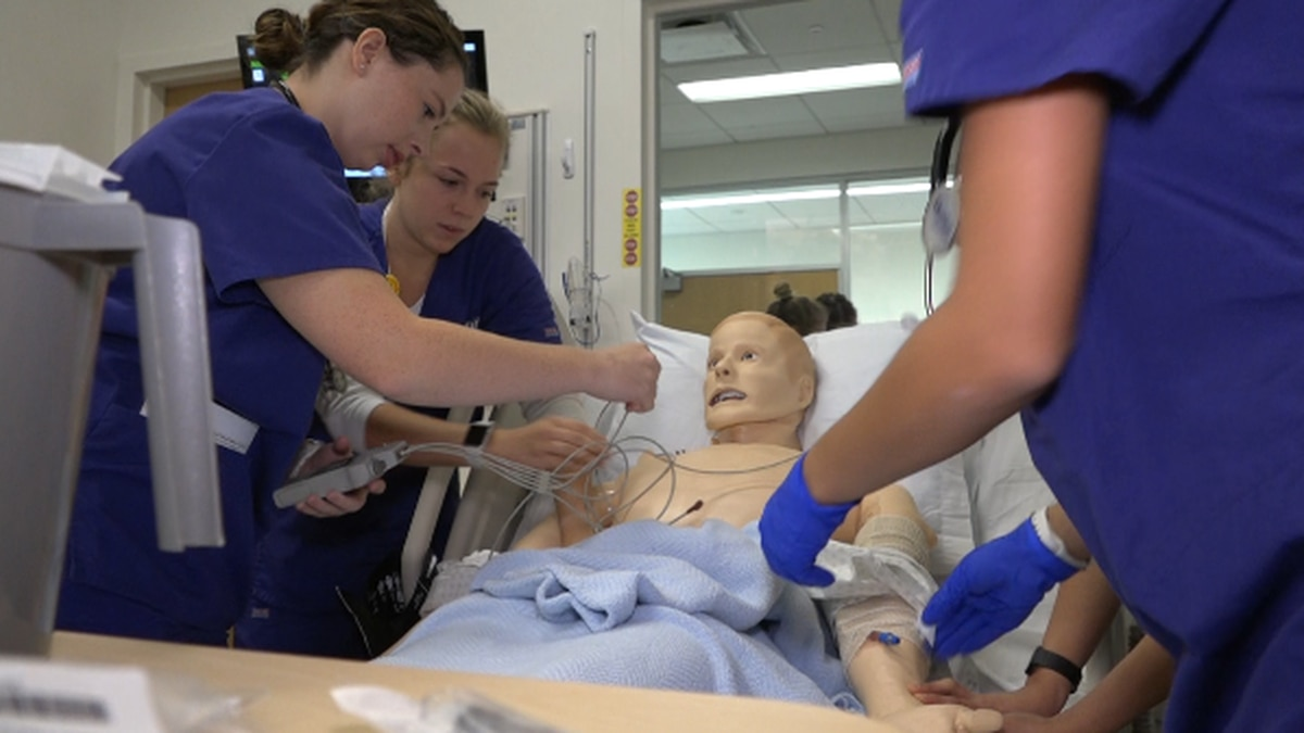 Students working through a scenario in one of the school's simulations laboratories.