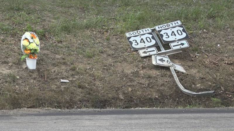 Flowers placed at the scene of the crash.