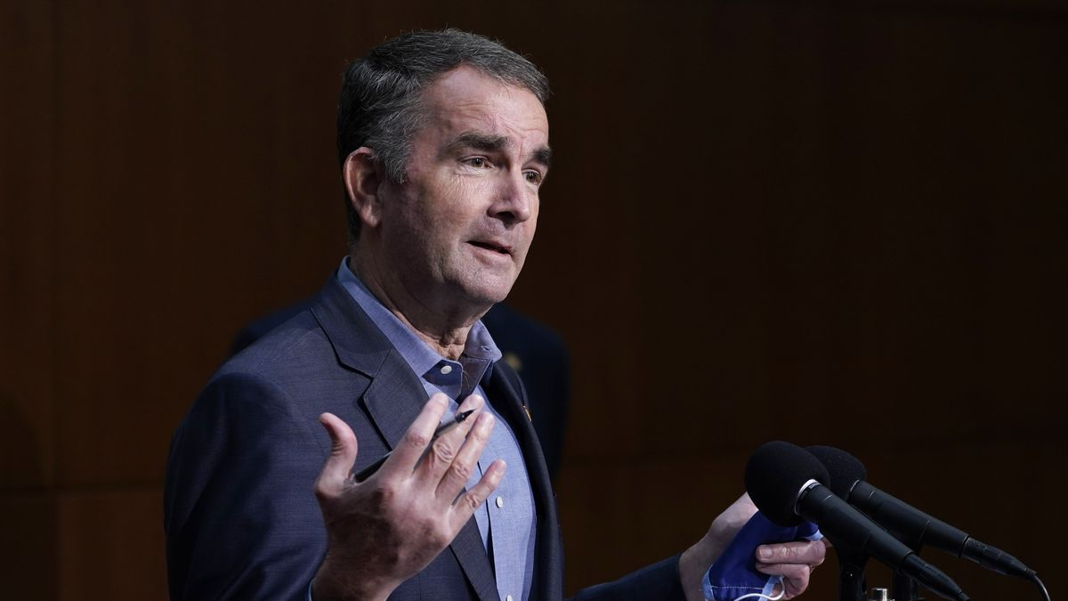 FILE - In this  Wednesday Nov 18, 2020. file photo, Virginia Gov. Ralph Northam gestures during...