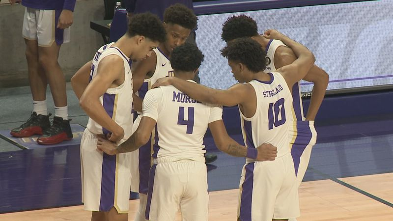 The James Madison men's basketball team is in first place in the CAA.