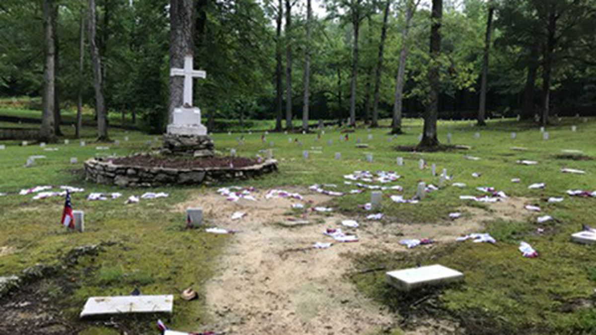 A deputy found dozens of Confederate flags scattered on the ground. Some of them spelled out...