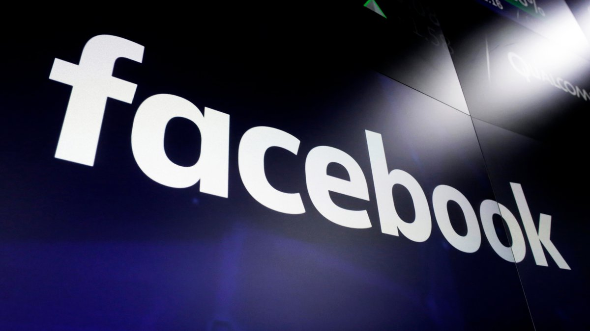 This March 29, 2018, file photo shows the Facebook logo on screens at the Nasdaq MarketSite, in...