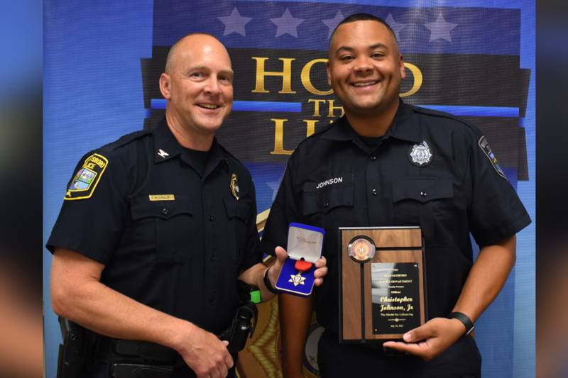 Waynesboro Police Chief Michael Wilhelm awarding Officer Chris Johnson with the Waynesboro...