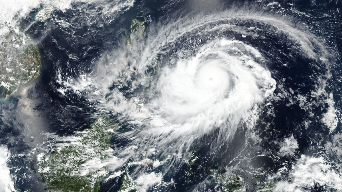 This April, 17, 2021 satellite image released NASA shows typhoon Surigae approaching...