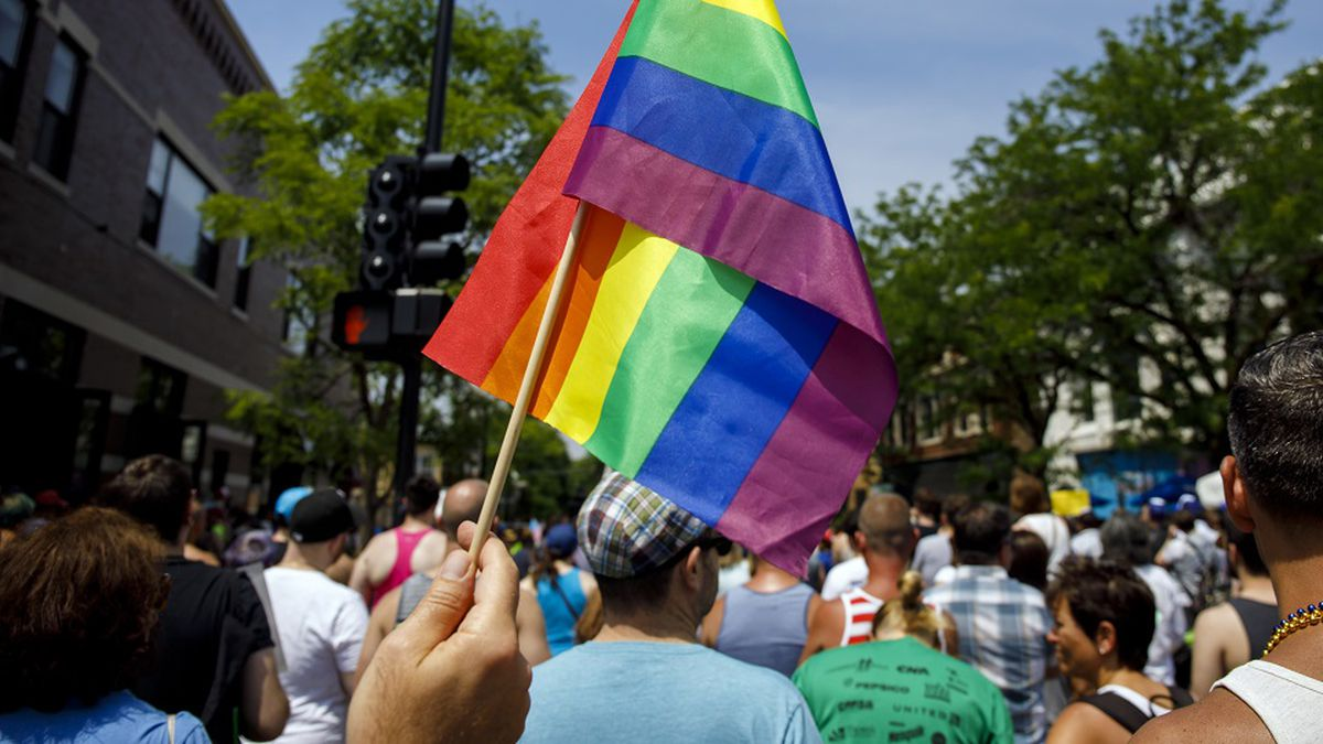 FILE - In this June 11, 2017 file photo people attend the LGBTQ Chicago Equality rally in the Andersonville neighborhood of Chicago. (Brian Cassella/Chicago Tribune via AP File)