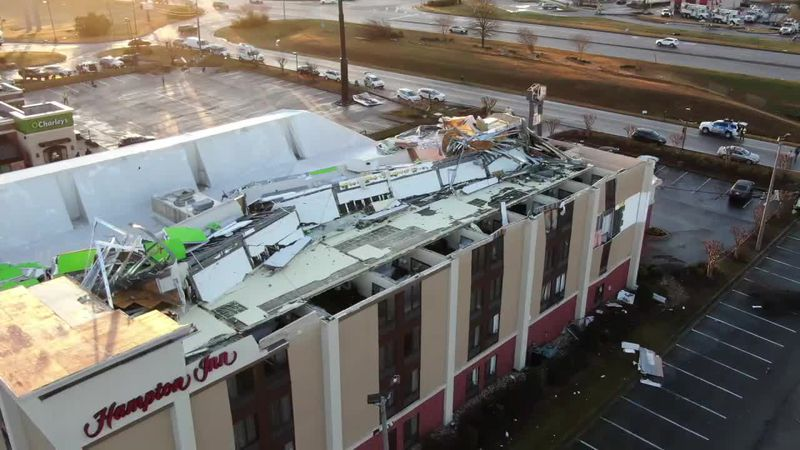 A Hampton Inn in Fultondale, Ala., received major damage after a suspected tornado plowed...