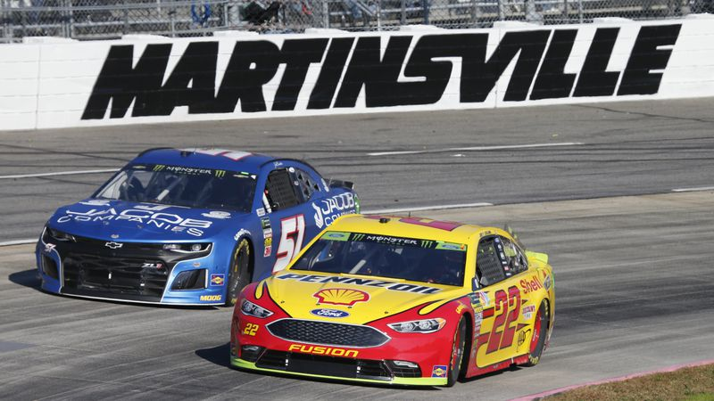 Driver Joey Logano (22) passes Jeb Burton (51)  during the Monster Energy NASCAR Cup Series...