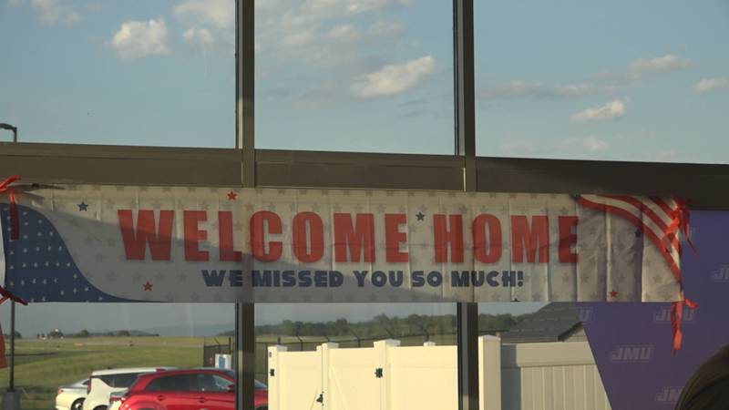 Loved ones surprise Bridgewater man and family at Shenandoah Valley Airport
