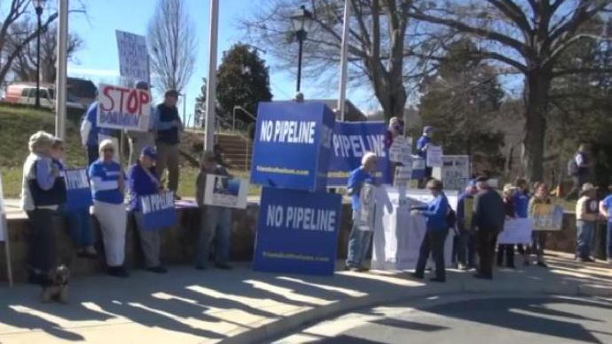 Protesters gather outside of the Nelson County courthouse to protest the Atlantic Coast Pipeline ahead of a hearing on allowing surveyors onto private property.