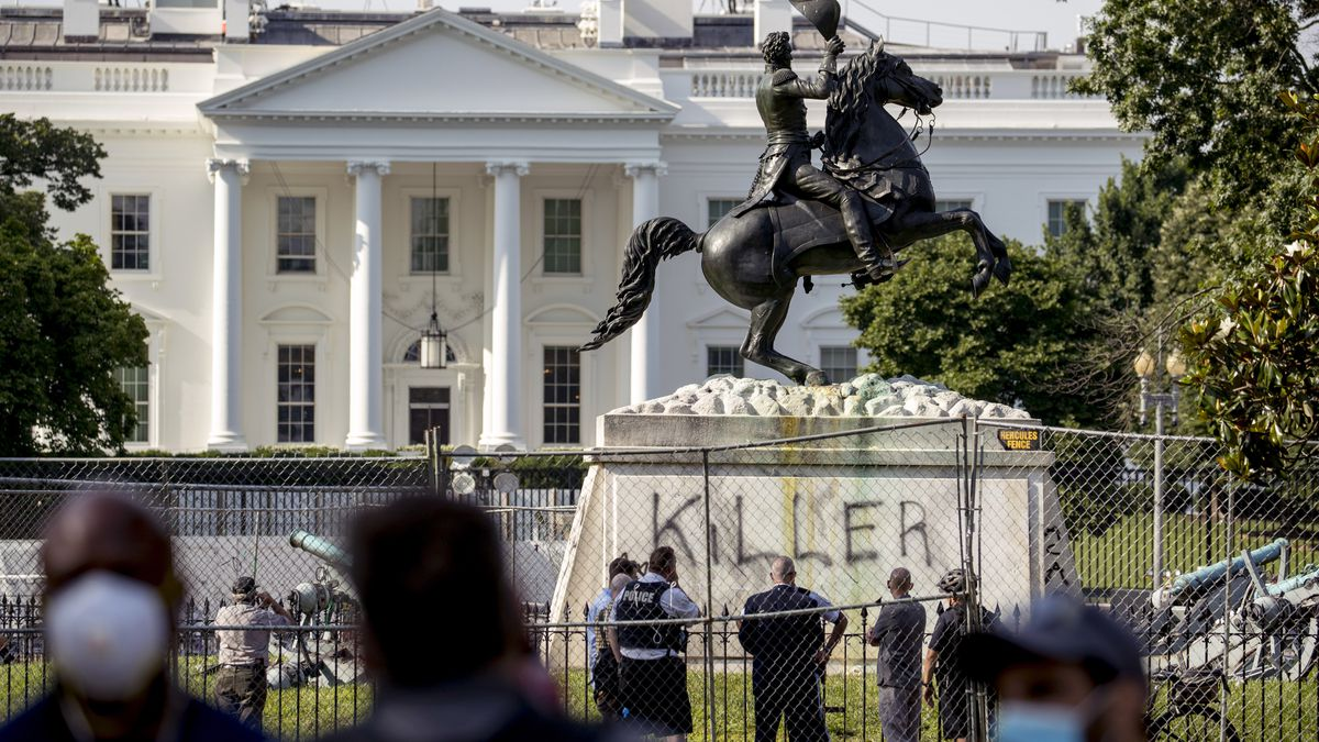 The White House is visible behind a statue of President Andrew Jackson in Lafayette Park,...