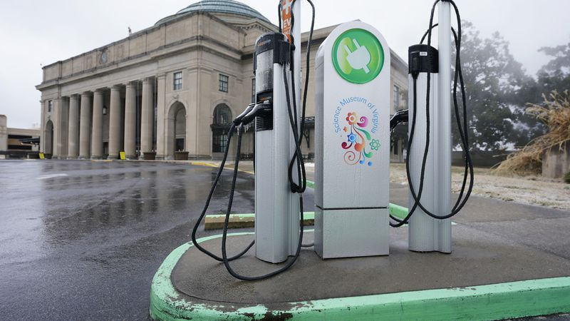 An electric car charging station is positioned outside the Science Museum where Virginia State...