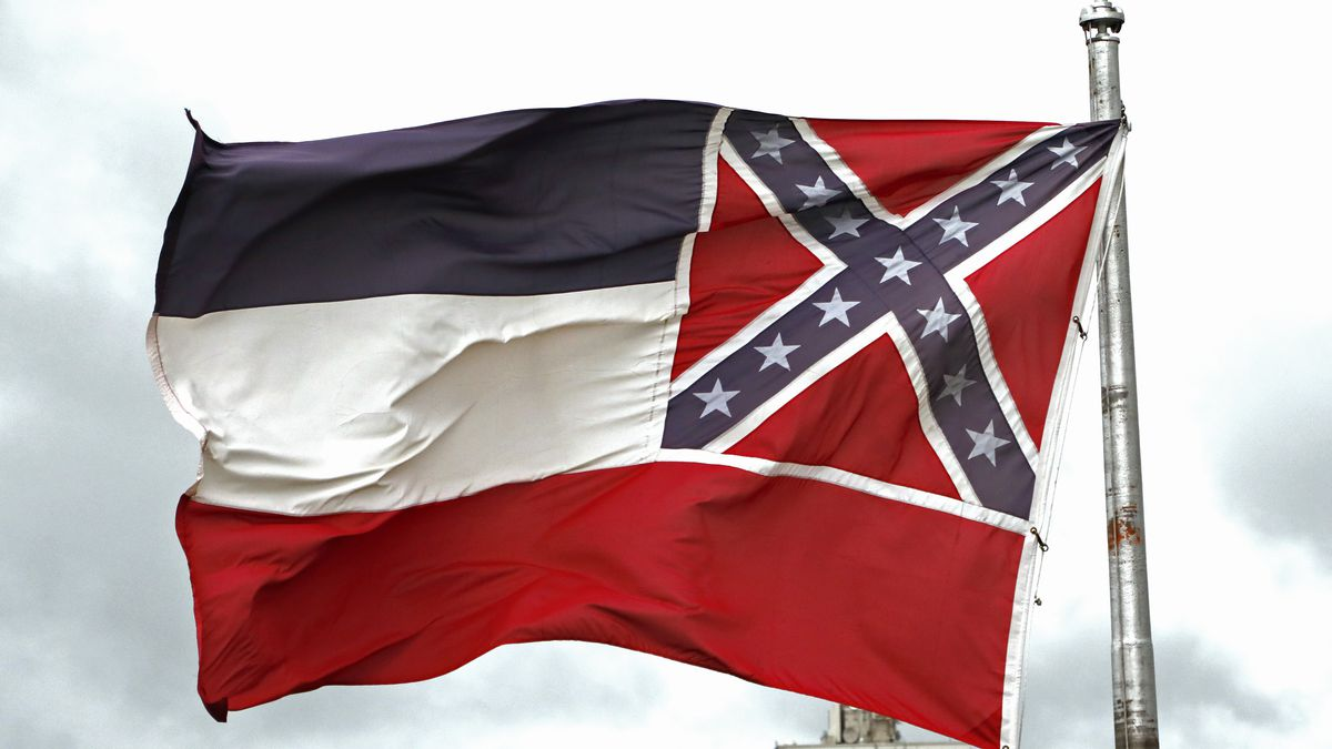 File-This June 25, 2020, file photo shows a Mississippi state flag flying outside the Capitol in Jackson, Miss. Mississippi will surrender the Confederate battle emblem from its state flag, more than a century after white supremacist legislators embedded it there a generation after the South lost the Civil War. Mississippi's House and Senate voted in succession Sunday, June 28, 2020, to retire the flag, with broad bipartisan support. Republican Gov. Tate Reeves has said he will sign the bill, and the state flag would lose its official status as soon as he signs the measure.