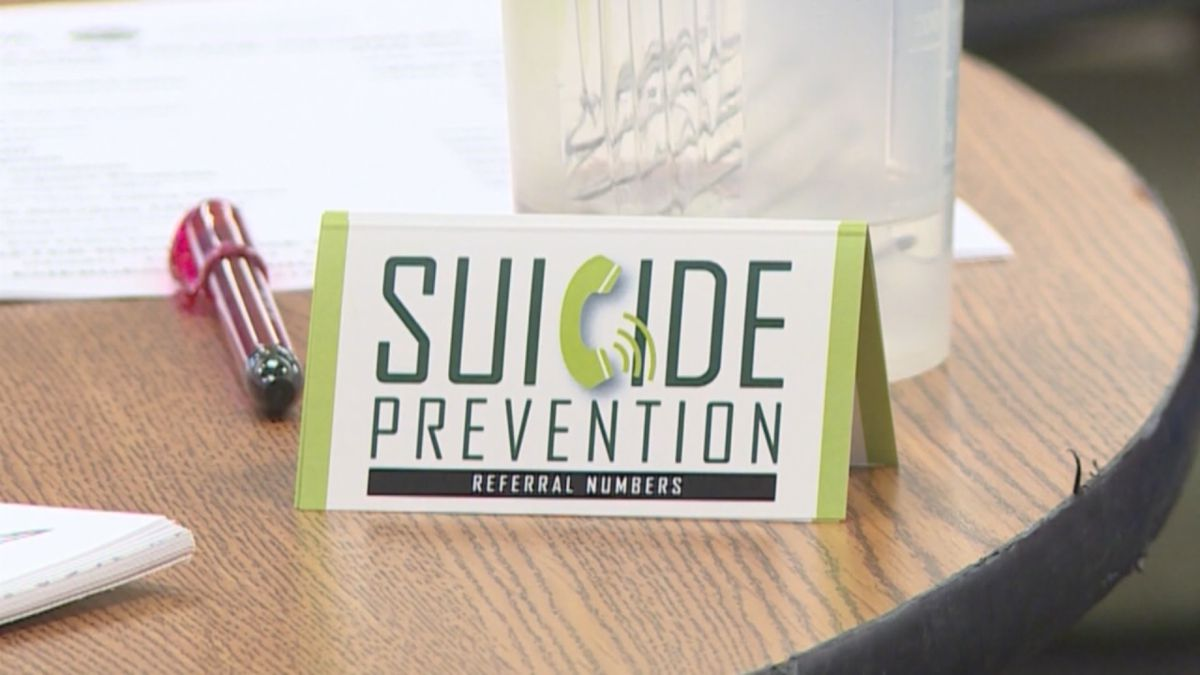 Suicide prevention referral numbers card