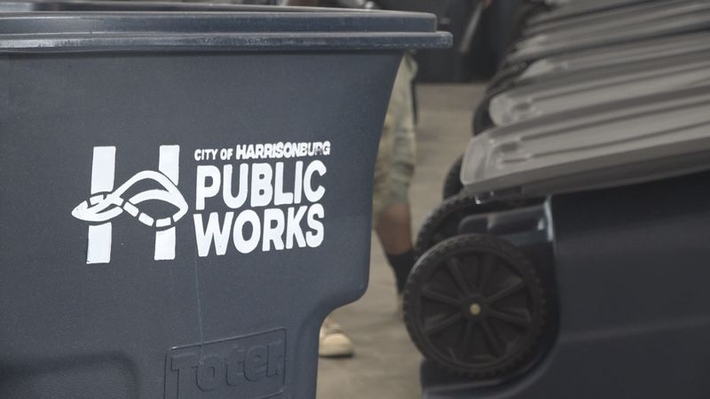 The city of Harrisonburg Public Works logo located on the side of the new trash carts.