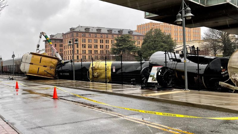 Norfolk Southern crews worked into the night Wednesday to clear nine cars that derailed in...
