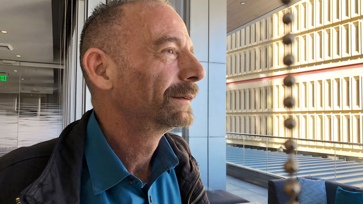"""FILE - This March 4, 2019 file photo shows Timothy Ray Brown in Seattle. Brown, who made history as """"the Berlin patient,"""" the first person known to be cured of HIV infection, died Tuesday, Sept. 29, 2020, at his home in Palm Springs, Calif., according to a social media post by his partner, Tim Hoeffgen. He was 54. The cause was a return of the cancer that originally prompted the unusual bone marrow and stem cell transplants Brown received in 2007 and 2008, which for years seemed to have eliminated both his leukemia and HIV, the virus that causes AIDS."""