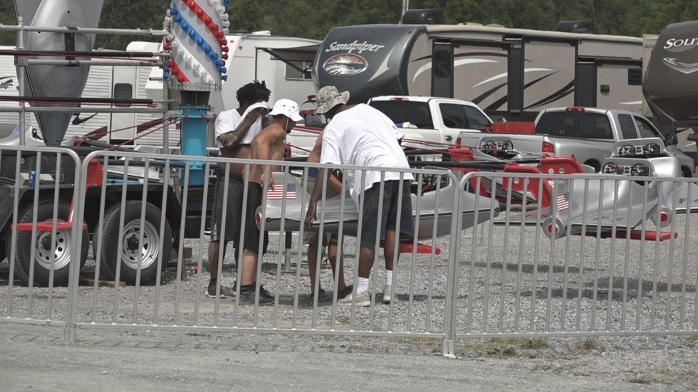 Augusta County Fair workers unload rides Monday, July 26.