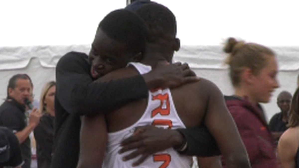 Members of UVA Track and Field hugging after an event