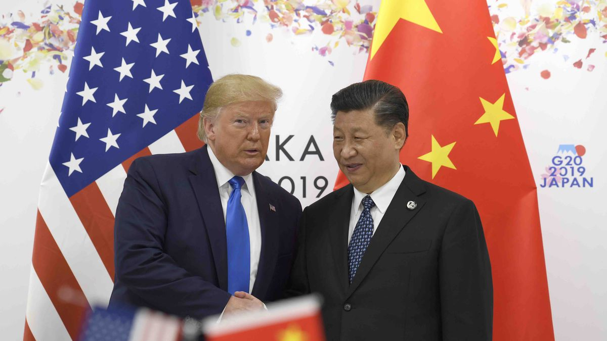 President Donald Trump poses for a photo with Chinese President Xi Jinping during a meeting on...
