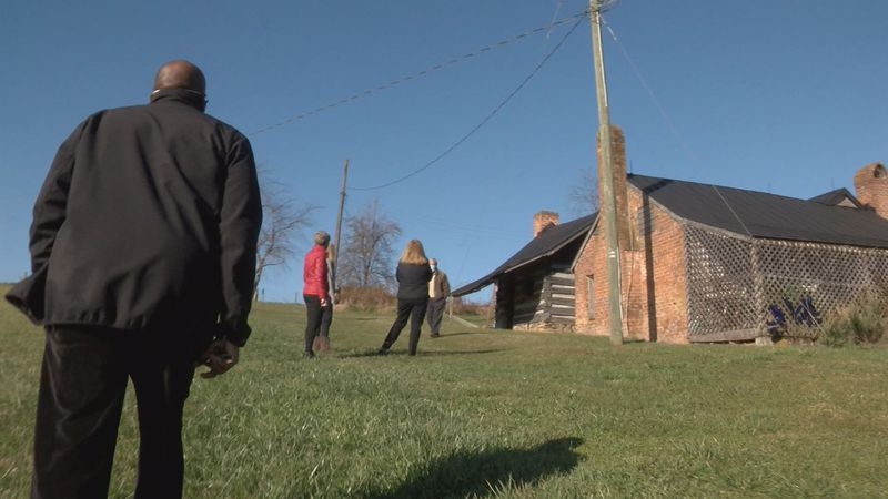 U.Va. Professor David Green walks toward the slave quarters on a farm where his ancestor...
