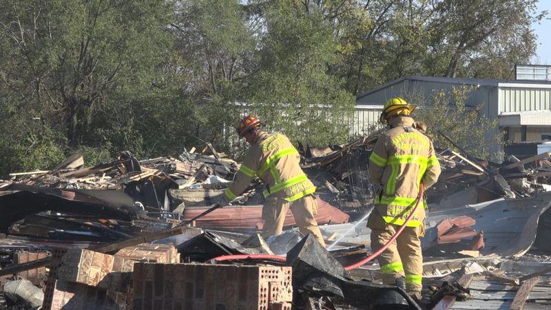 Harrisonburg Firefighters hosing down explosion debris from the Miller Circle shopping center.