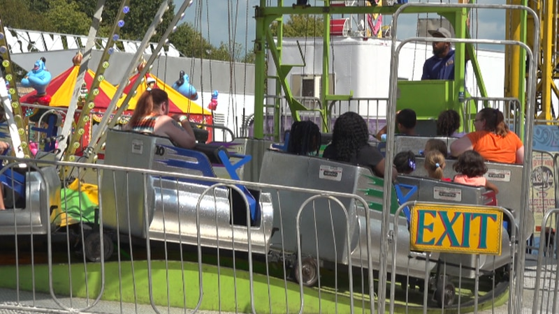 People on a ride at the fair Sunday.