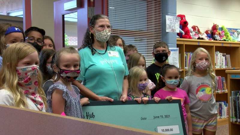 Mrs. C honored with a $10,000 check