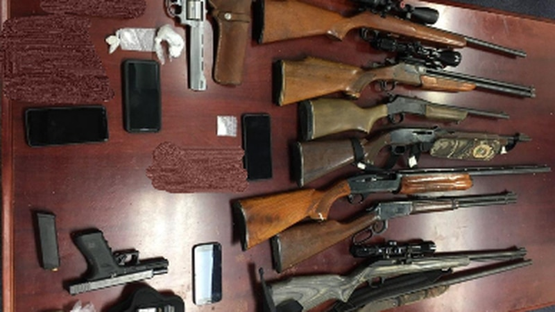 Virginia State Police report officials seized 15 firearms during the search warrants.