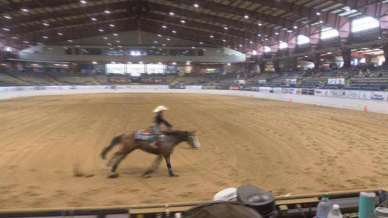 A competitor at the North American Reining Stakes rides at the Virginia Horse Center.
