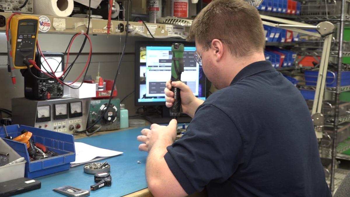 Matthew Campbell works with electronic components at ComSonics in Harrisonburg.
